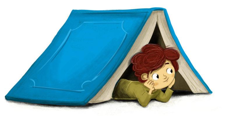 chłopiec pod książką